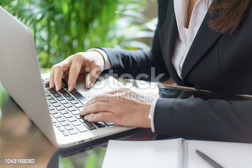 663458084 istock photo Business woman working with a laptop. Business and law concept. Selective focus 1043169262