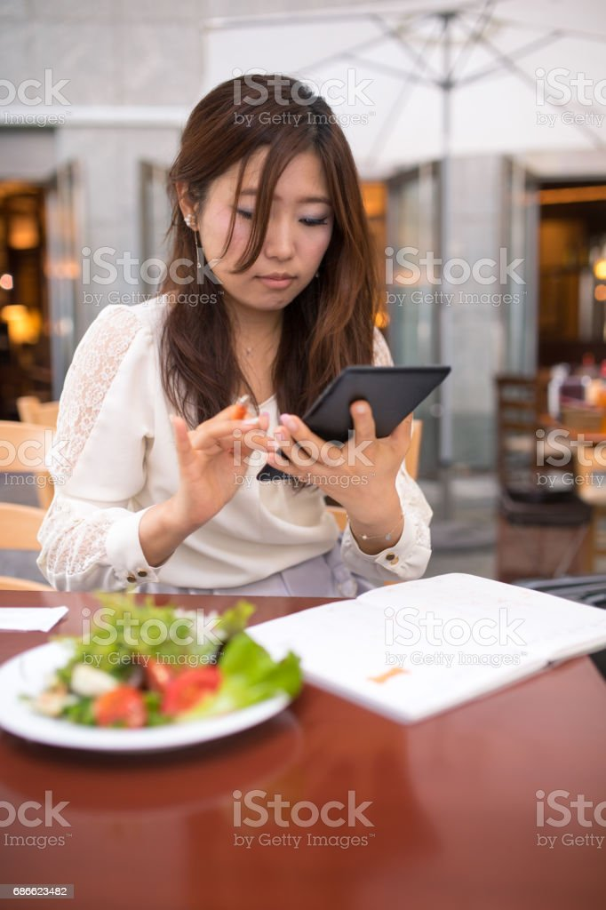 Business woman working with digital tablet during lunch royalty-free stock photo