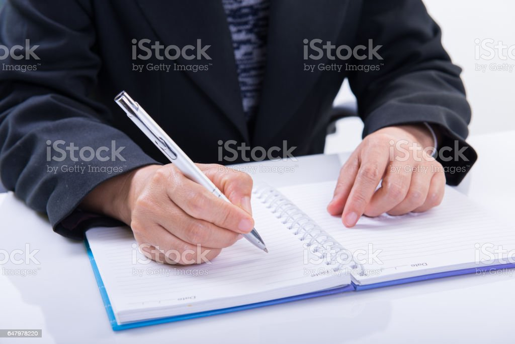Business woman working with documents in office stock photo