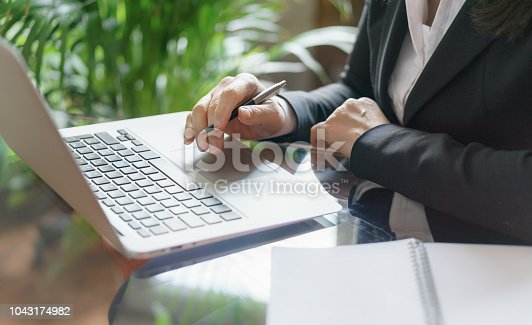 663458084 istock photo Business woman working with laptop, copybook and pen. Business and law concept. Selective focus 1043174982