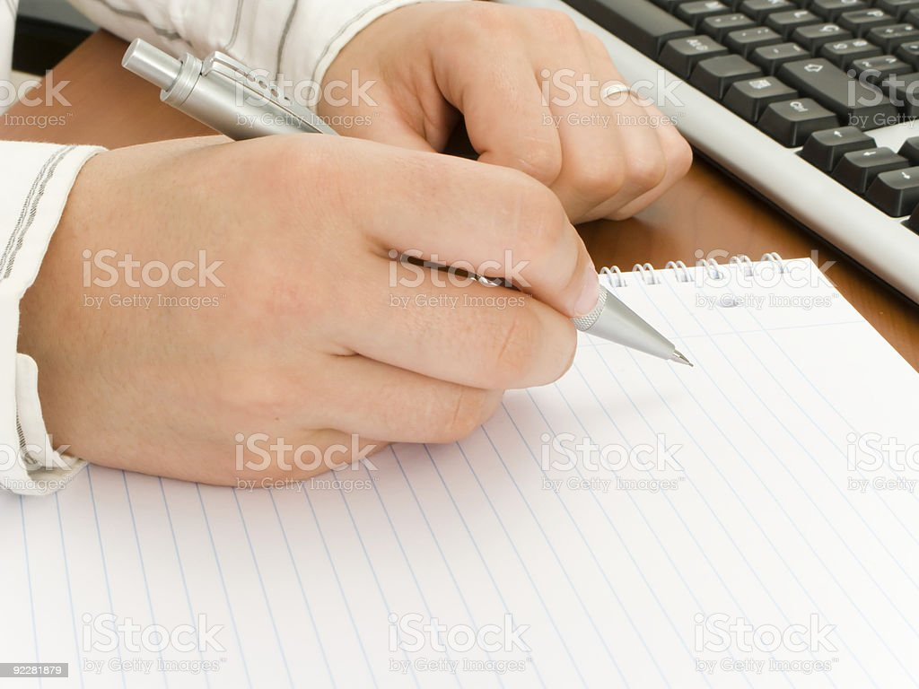 Business woman writing in a notebook royalty-free stock photo