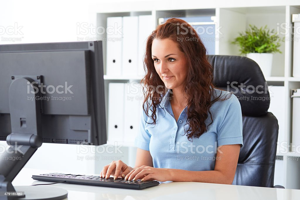Business woman writing on a computer stock photo