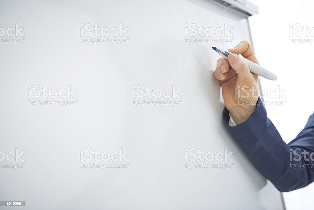 Business woman writing on flipchart. Closeup stock photo