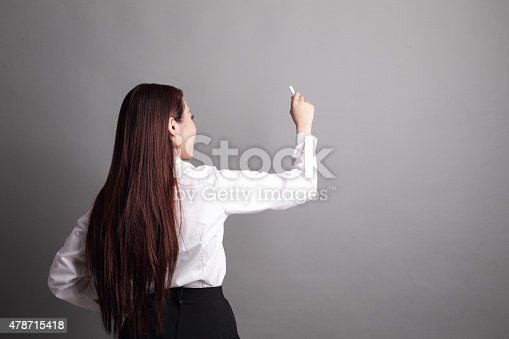 istock business woman writing 478715418