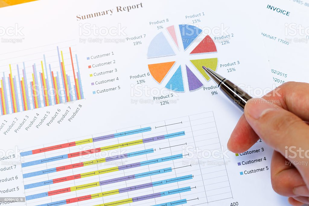 Business woman's hand checking the results on paperwork. stock photo