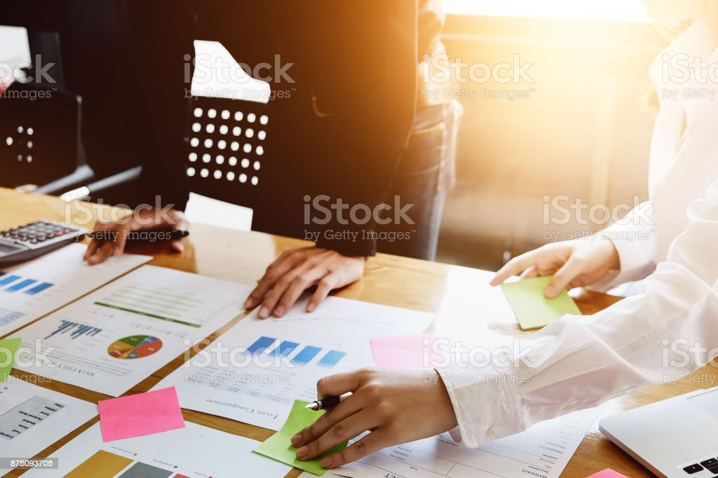 Business women are consulting a team of marketing experts to increase their sales and advertising strategies in office. stock photo
