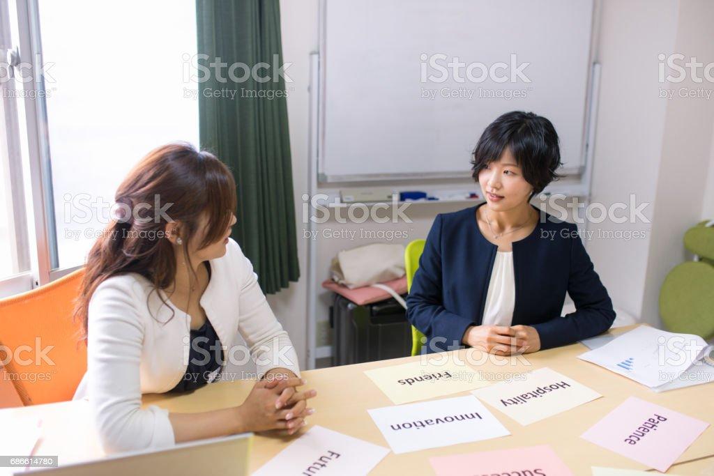 Business women brainstorming in meeting room royalty-free stock photo