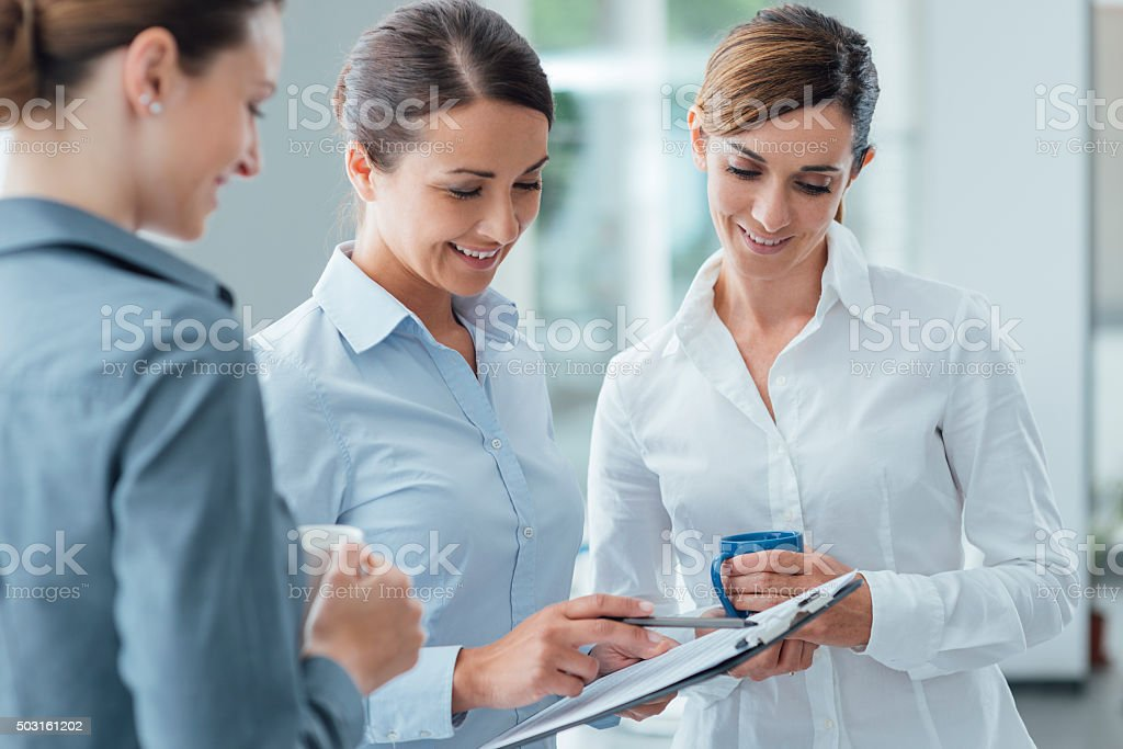 Business women discussing during a coffee break stock photo