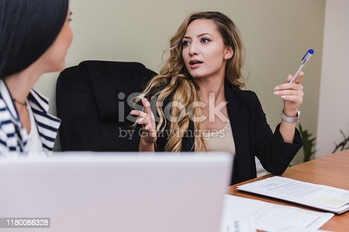 1085713886 istock photo Business women discussing work 1180086328