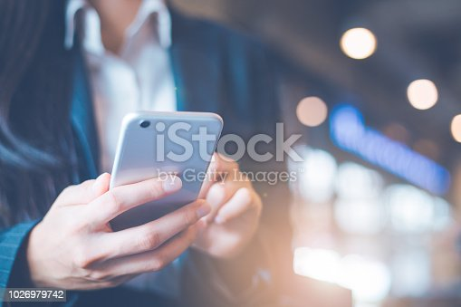 istock Business women hand are using cell phones in office. 1026979742