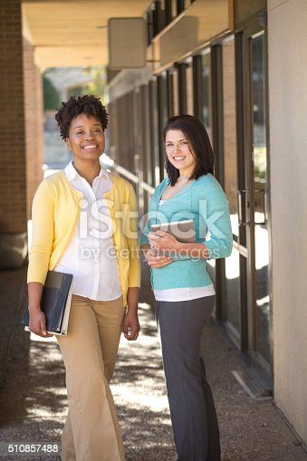 istock Business women standing outside an office building. 510857488