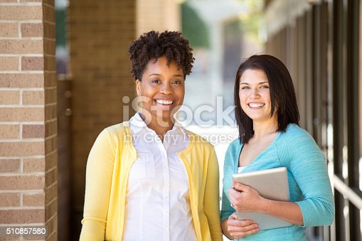 istock Business women standing outside an office building. 510857580