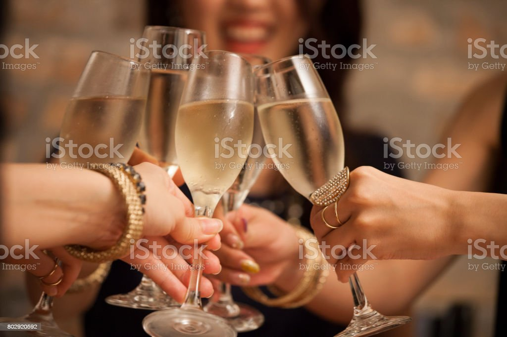 Business women toast with a glass of wine in hand. stock photo