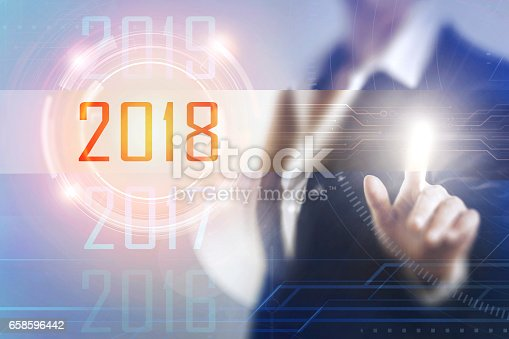 823410098 istock photo Business women touching the 2018 screen 658596442