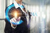Business women touching the media screen