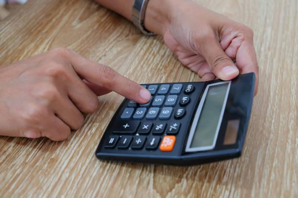 Business women using calculator stock photo