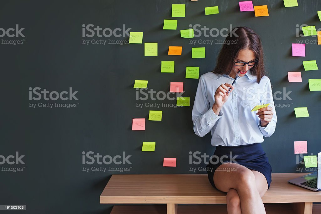 Business women with paper stickers sitting on a bench stock photo