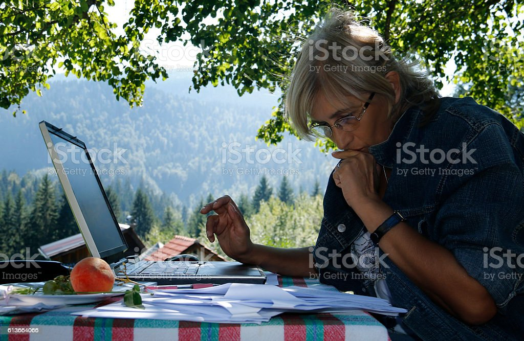 Business women working outdoors on a laptop stock photo