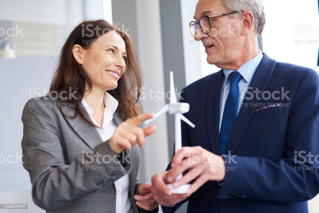 Business workers having a conversation about wind energy
