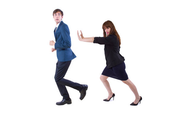 Business Workers Pushing Each Other Away stock photo
