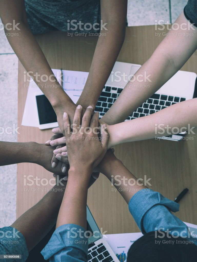 business working team put hand together for fighting; working team building stock photo