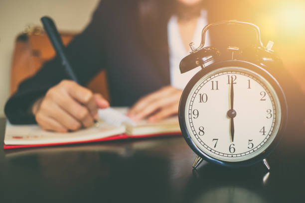 business working time concept. morning 6 o'clock with work people on background stock photo