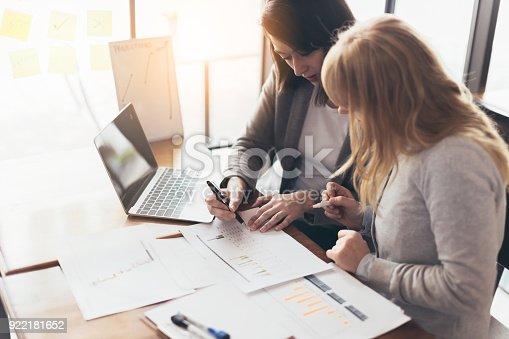istock business working with woman and friend with laptop and paperwork with color tone effect 922181652