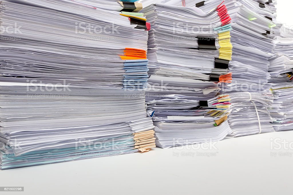 Business workload concept. Pile of unfinished business documents on office Lizenzfreies stock-foto