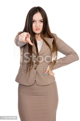 Business young woman pointing finger right isolated over white background. Asian angry woman with long hair in a beige suit