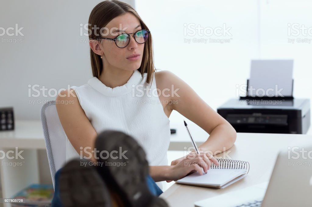Business young woman working in the office. stock photo