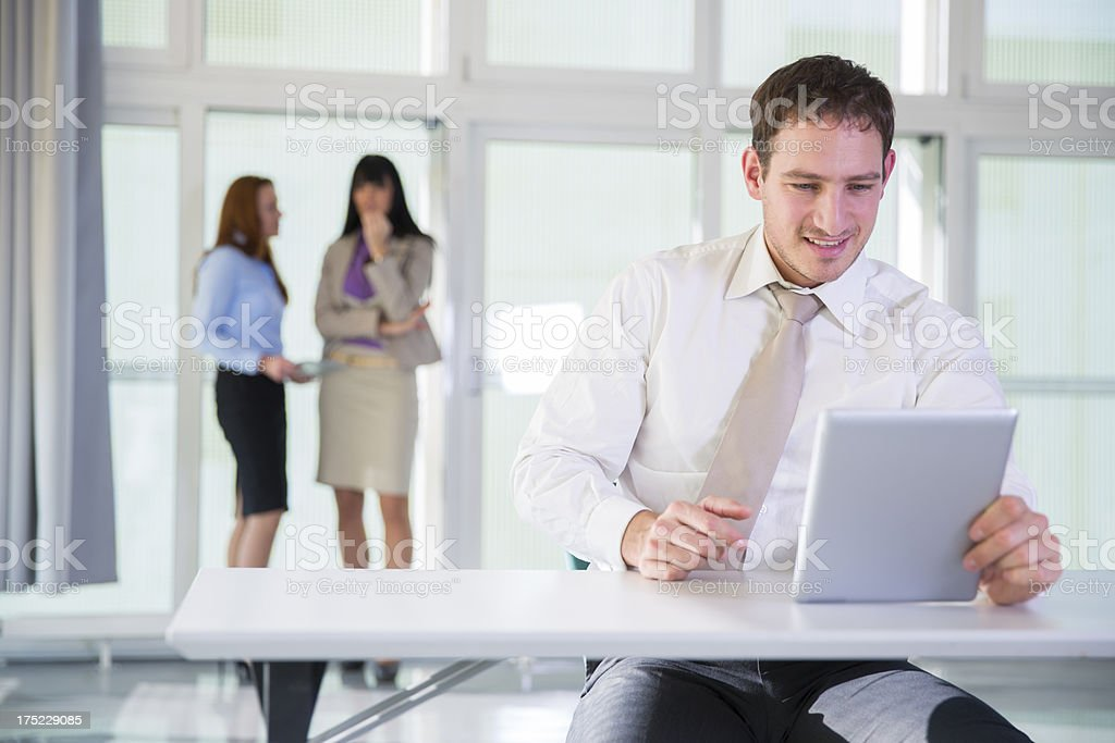 Businesse people relaxing..man plying with his digital tablet. royalty-free stock photo
