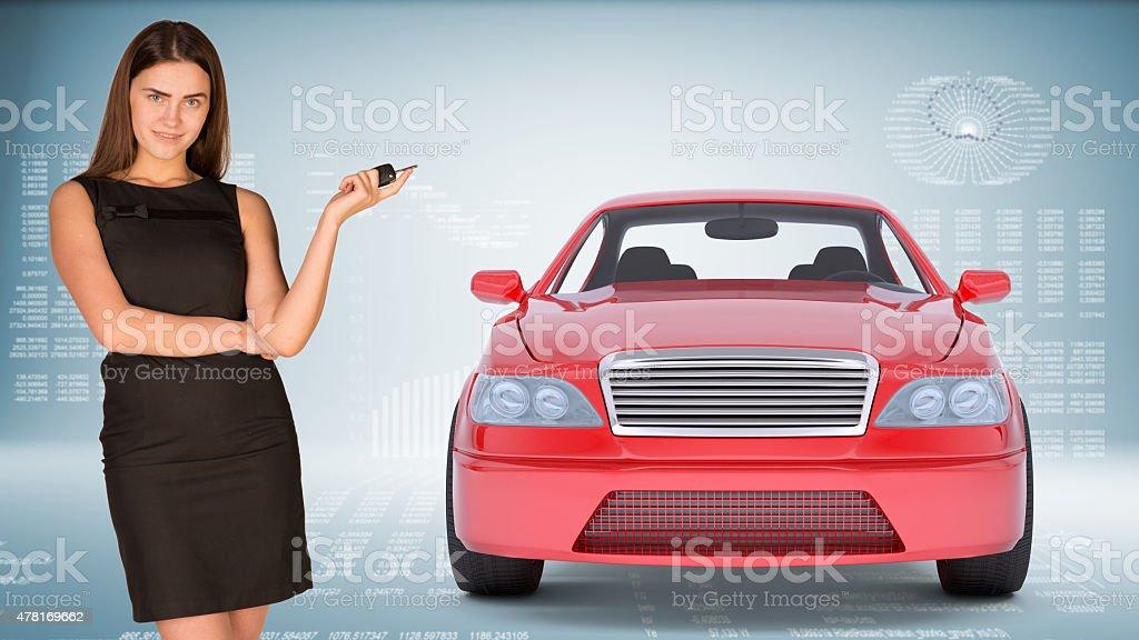 Businesslady holding car key stock photo