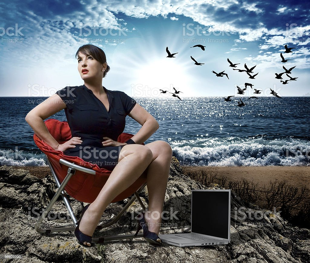businesslady on a beach with dramatic sunlight royalty-free stock photo