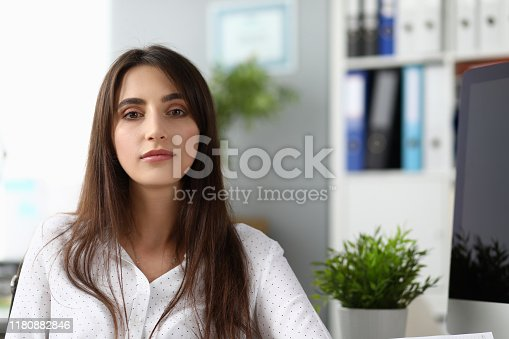 Portrait of beautiful businesswoman wearing strict white blouse. Wonderful lady working in international designer company. Business and art design concept. Blurred background