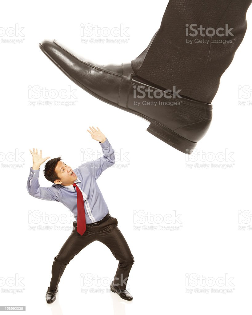 Businessman About To Be Stepped On royalty-free stock photo