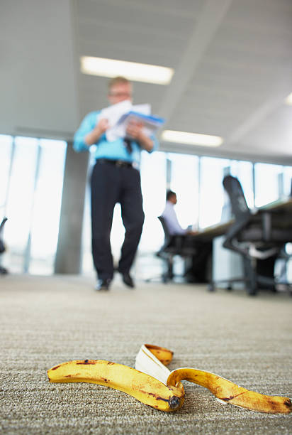 Businessman about to step on banana peel  banana peel stock pictures, royalty-free photos & images