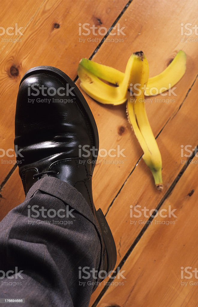 businessman about to step on banana skin royalty-free stock photo