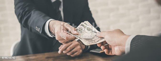 istock Businessman accepting Japanese Yen money 876018742