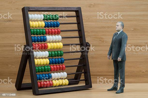 Businessman Action Figure With Abacus Stock Photo - Download Image Now