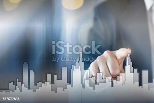 istock Businessman Activate Growth Process, choosing house, real estate city concept. Skyline Hand pressing the house icon on virtual screen. Business, technology, internet and networking concept. Copy space 877072828