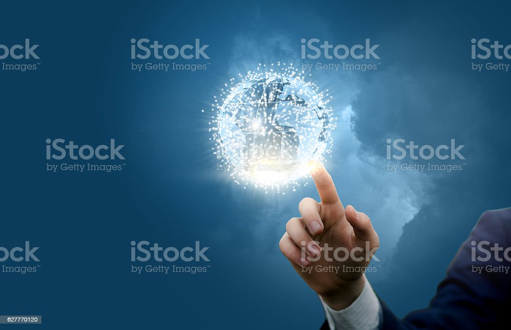 Businessman activates global network stock photo
