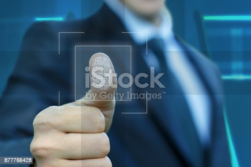 istock Businessman activates the input fingerprint . 877766428