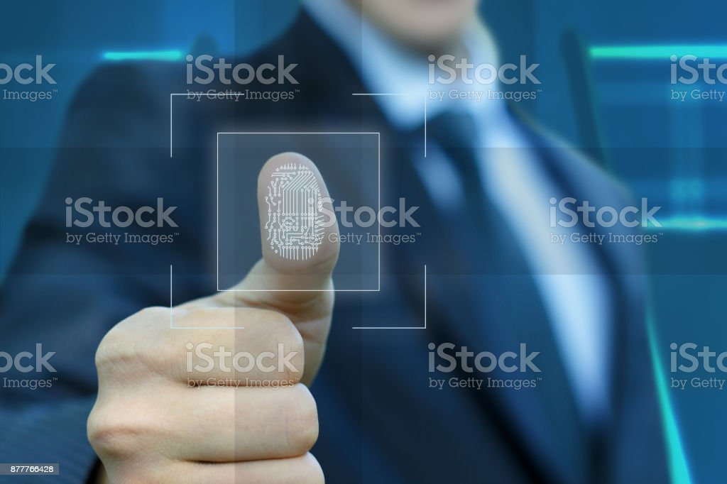 Businessman activates the input fingerprint . stock photo