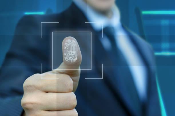 businessman activates the input fingerprint . - fingerprint stock photos and pictures