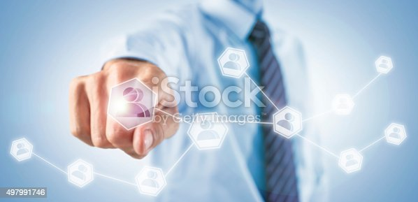 istock Businessman adding social friends on his network 497991746