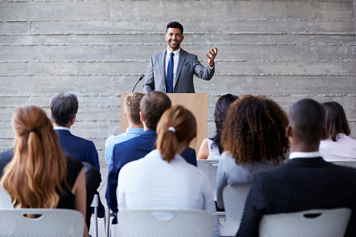 Businessman Addressing Delegates At Conference Stock Photo - Download Image Now