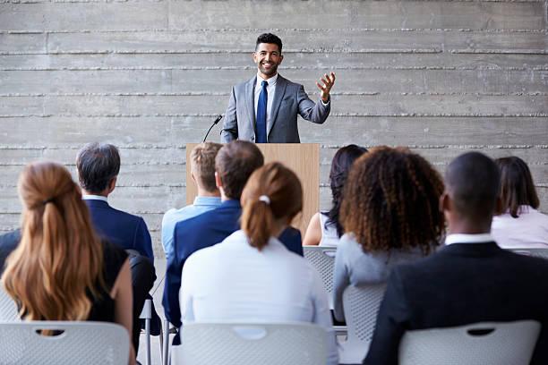 Businessman Addressing Delegates At Conference stock photo