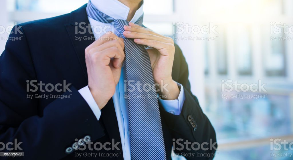 3029966779a9 Businessman Adjusting His Tie Stock Photo & More Pictures of ...