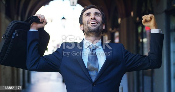 A businessman after a working visit to exult phone to have received a promotion or winning a bet. Concept: finance, business, exultation, victory, bet, working career.