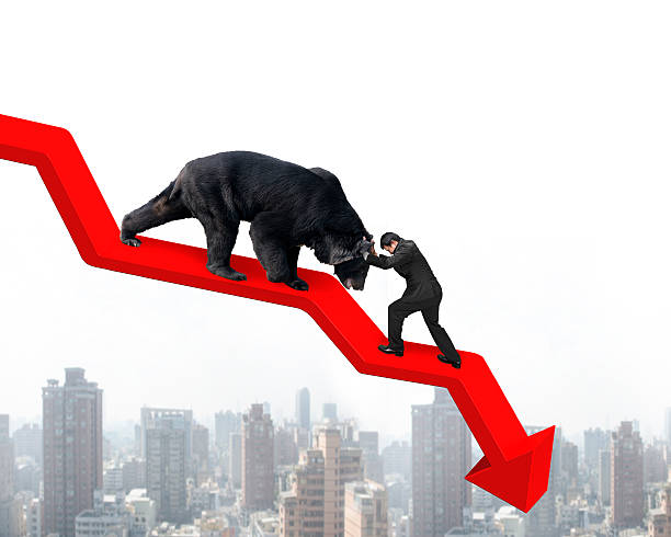 Businessman against bear on arrow downward trend line with citys stock photo